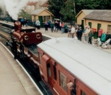 Furness Railway Number 20 waits departure from Pickering with another fully loaded train
