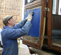 David Rimmer attaches upholstery to one of the doors