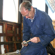 John Dixon glueing a patch ready to be screwed into the interior of the external panels